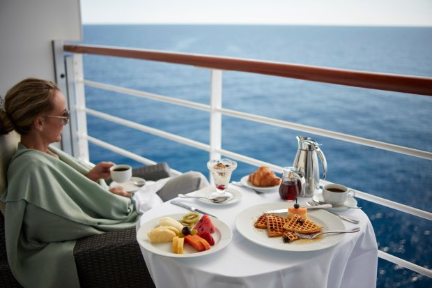 Oceania Cruises room service woman balcony deck